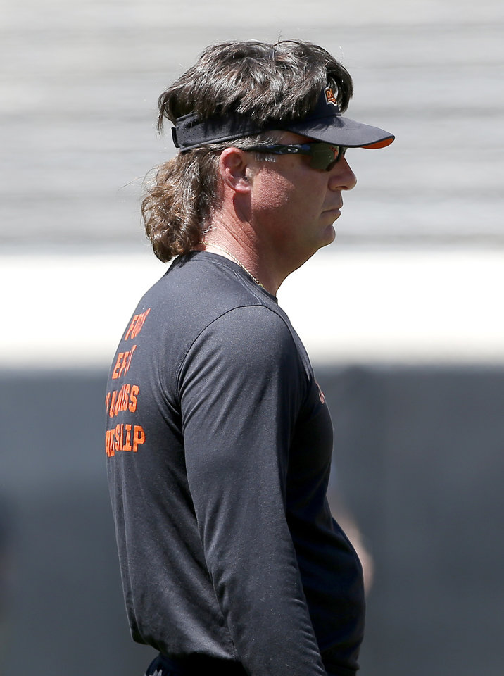 Photo - Oklahoma State head coach Mike Gundy watches practice during the Oklahoma State Cowboys spring practice at Boone Pickens Stadium in Stillwater, Okla., Saturday, April 20, 2019.  Photo by Sarah Phipps, The Oklahoman
