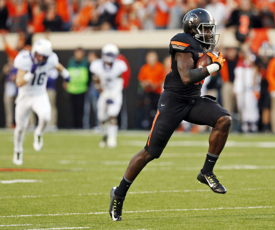Photo - Oklahoma State's James Washington (28) takes a catch for a touchdown in the third quarter during the college football game between the Oklahoma State Cowboys (OSU) and TCU Horned Frogs at Boone Pickens Stadium in Stillwater, Okla., Saturday, Nov. 7, 2015. OSU won 49-29. Photo by Nate Billings, The Oklahoman