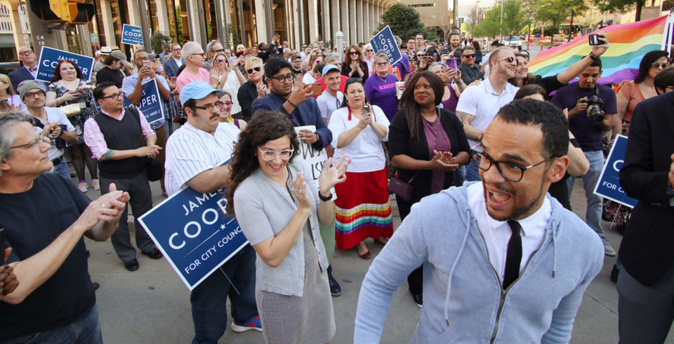 Photo -  Marchers join Councilman-elect James Cooper in a march from Park Avenue and Broadway to City Hall in support of Cooper, who will become the first openly gay city councilman when sworn in on Tuesday. [Doug Hoke/The Oklahoman]