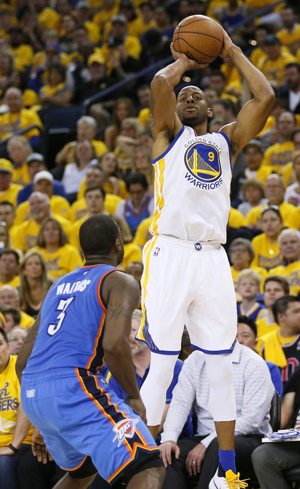Photo - Golden State's Andre Iguodala (9) shoots against Oklahoma City's Dion Waiters (3) in the fourth quarter during Game 2 of the Western Conference finals in the NBA playoffs between the Oklahoma City Thunder and the Golden State Warriors at Oracle Arena in Oakland, Calif., Wednesday, May 18, 2016. Golden State won 118-91. Photo by Nate Billings, The Oklahoman