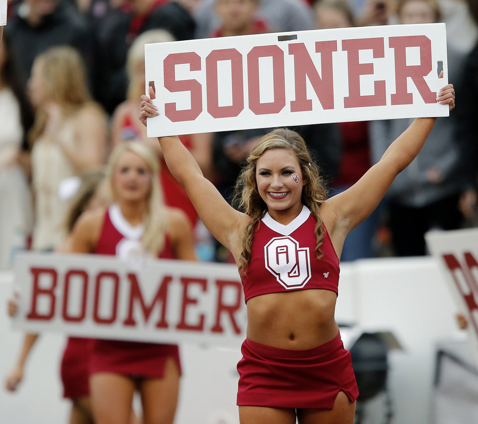 Photo - Members of the Oklahoma cheer squad perform during the college football game between the University of Oklahoma Sooners (OU) and the University of Texas Longhorns (UT) during the Red River Showdown at the Cotton bowl in Dallas, Texas on Saturday, Oct. 11, 2014. Photo by Chris Landsberger, The Oklahoman