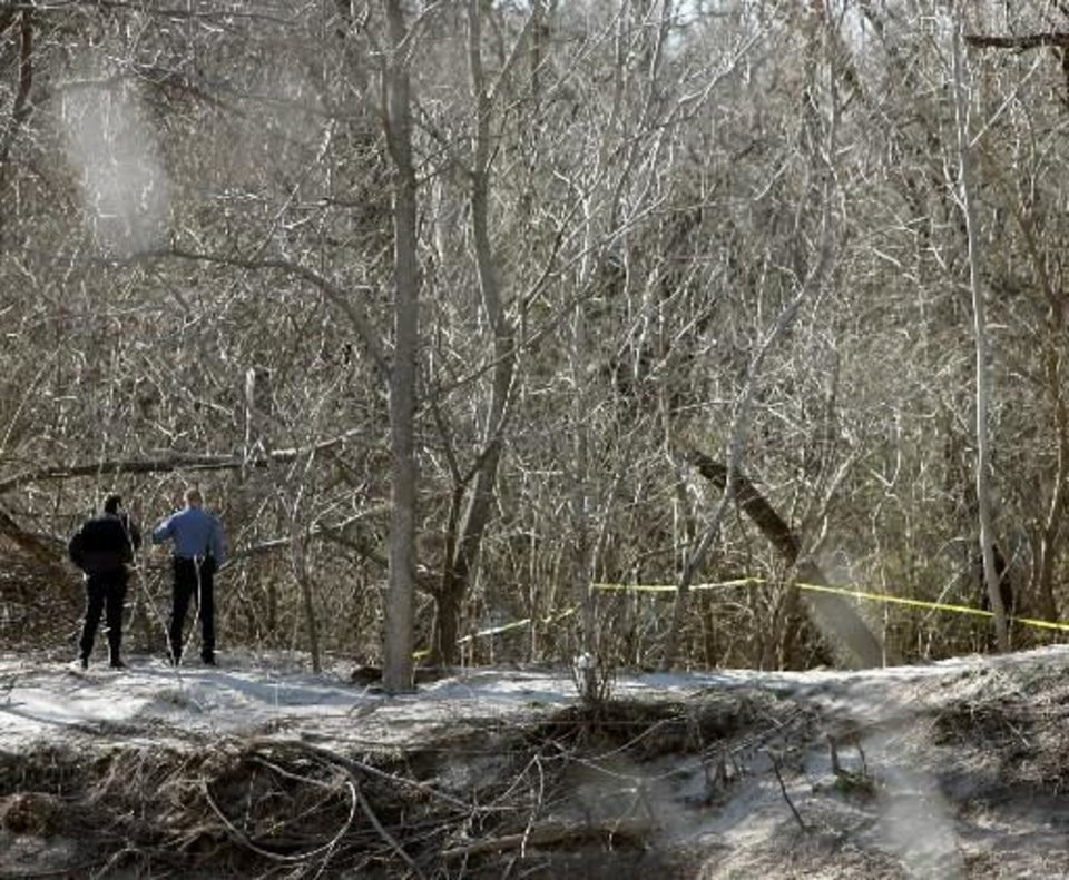 Photo - Officials survey the scene of a plane crash in Oklahoma City today. Photo by John Clanton