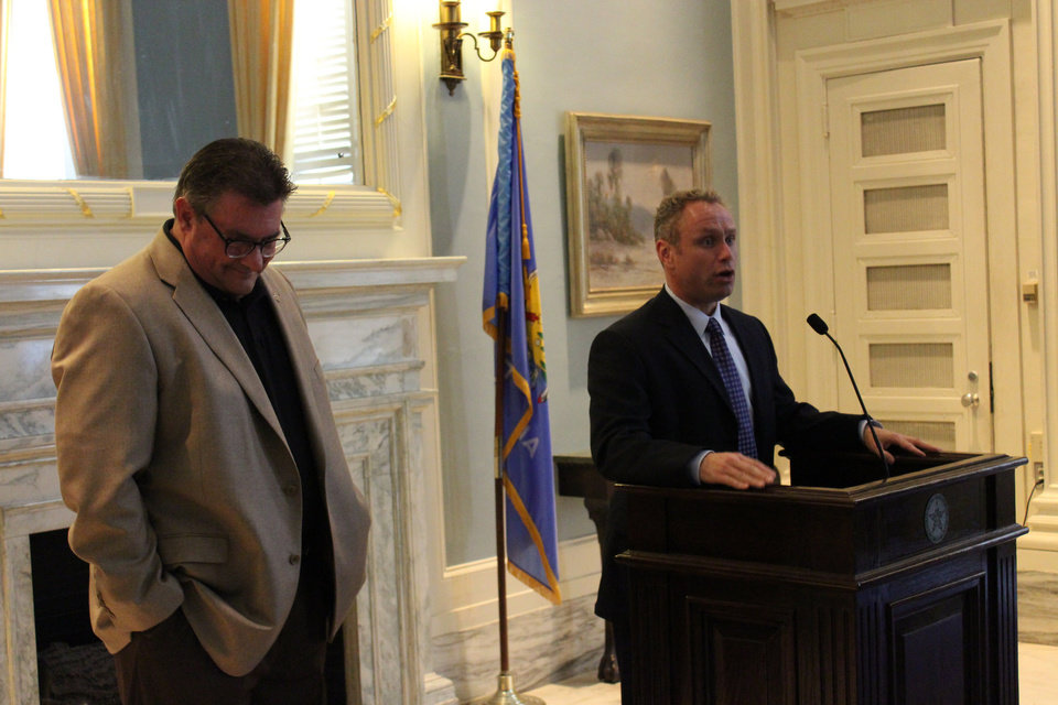 Photo -  Richard Phillips, Oklahoma Association of Realtors contract lobbyist, and Brad Worster, Norman, association government affairs committee chairman, at Real Estate Day at the Capitol April 6. [PHOTO PROVIDED BY OKLAHOMA ASSOCIATION OF REALTORS]