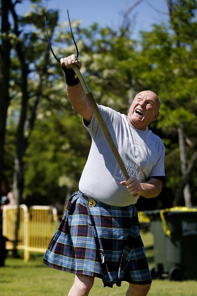 Photo - Dean Ross of Tulsa competes in the sheaf toss during during the Iron Thistle Scottish Festival in Yukon, Okla., Saturday, April 27, 2019. [Bryan Terry/The Oklahoman Archives]