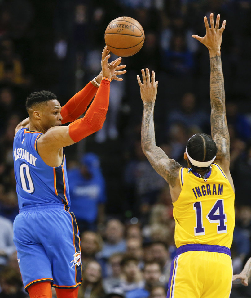 Photo - Oklahoma City's Russell Westbrook (0) passes next to Los Angeles' Brandon Ingram (14) during an NBA basketball game between the Los Angeles Lakers and the Oklahoma City Thunder at Chesapeake Energy Arena in Oklahoma City, Thursday, Jan. 17, 2019. Los Angeles won 128-138 in overtime. Photo by Nate Billings, The Oklahoman