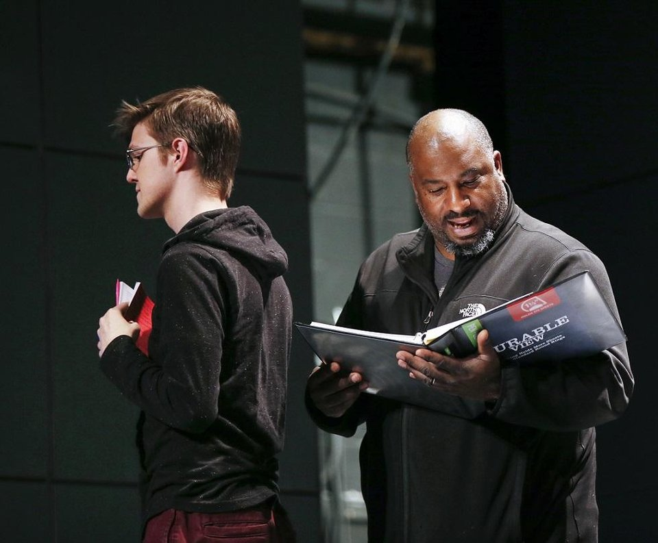 Photo - Director W. Jerome Stevenson, right, speaks next to Cameron Law, who plays Christopher Boone, during rehearsals for CityRep's production of the Tony-winning play