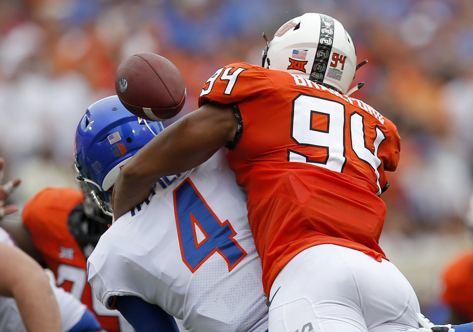 Photo - Oklahoma State's Dayton Metcalf (84) forces Boise State's Brett Rypien (4) to fumble in the second quarter during a college football game between the Oklahoma State Cowboys (OSU) and the Boise State Broncos at Boone Pickens Stadium in Stillwater, Okla., Saturday, Sept. 15, 2018. OSU won 44-21. Photo by Sarah Phipps, The Oklahoman