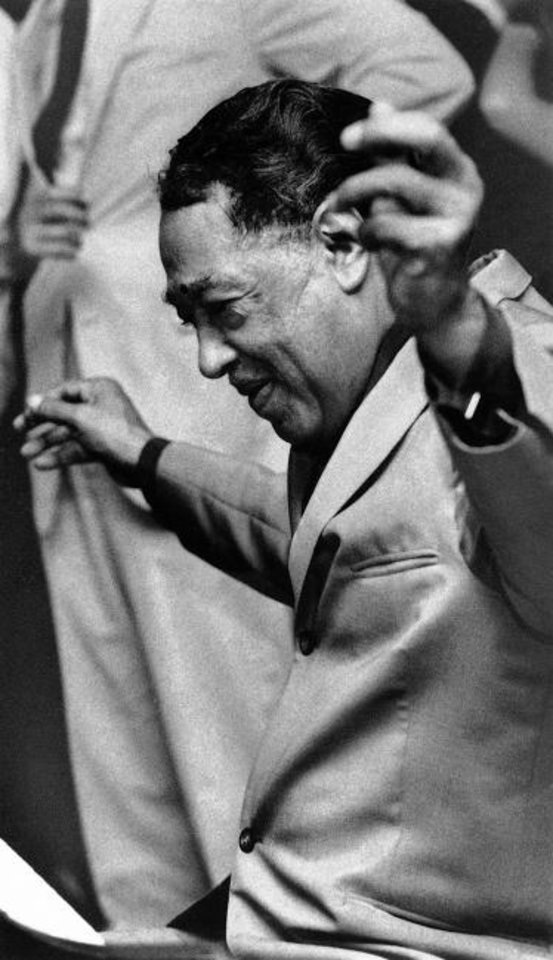 Photo -  Duke Ellington performs on Aug. 31, 1967, with his band at the Rainbow Grill in New York. [AP File Photo/Marty Lederhandler]
