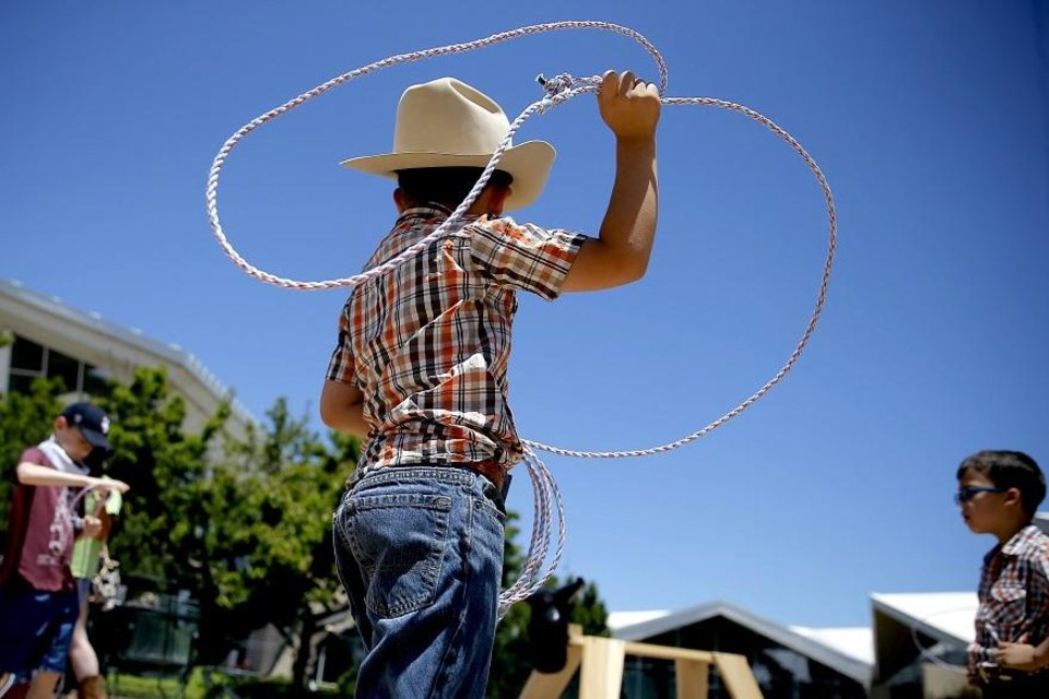 Photo - Alejandro Escobar, 7, throws his rope during the Chuck Wagon Festival at the National Cowboy & Western Heritage Museum in Oklahoma City, Saturday, May 26, 2018. [Bryan Terry/The Oklahoman Archives]