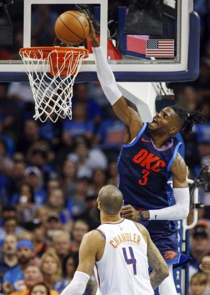 Photo -  Oklahoma City's Nerlens Noel dunks the ball during a game against Phoenix last October. Noel has reportedly re-signed with the Thunder. [Nate Billings/The Oklahoman]