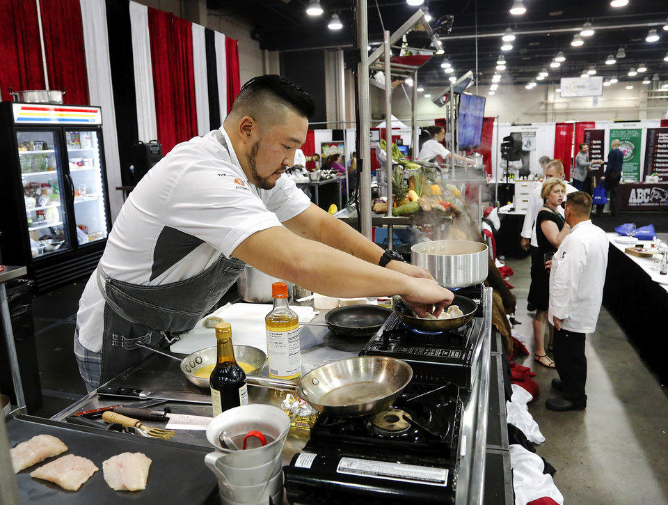 Photo -  Chef Kevin Lee, with Vast Restaurant, works during the Culinary Cook-off at the Oklahoma Restaurant Association Convention and Expo in Oklahoma City. The statewide competition pitted the state's top chefs against each other in a blind competition. [Photo by Jim Beckel, The Oklahoman]