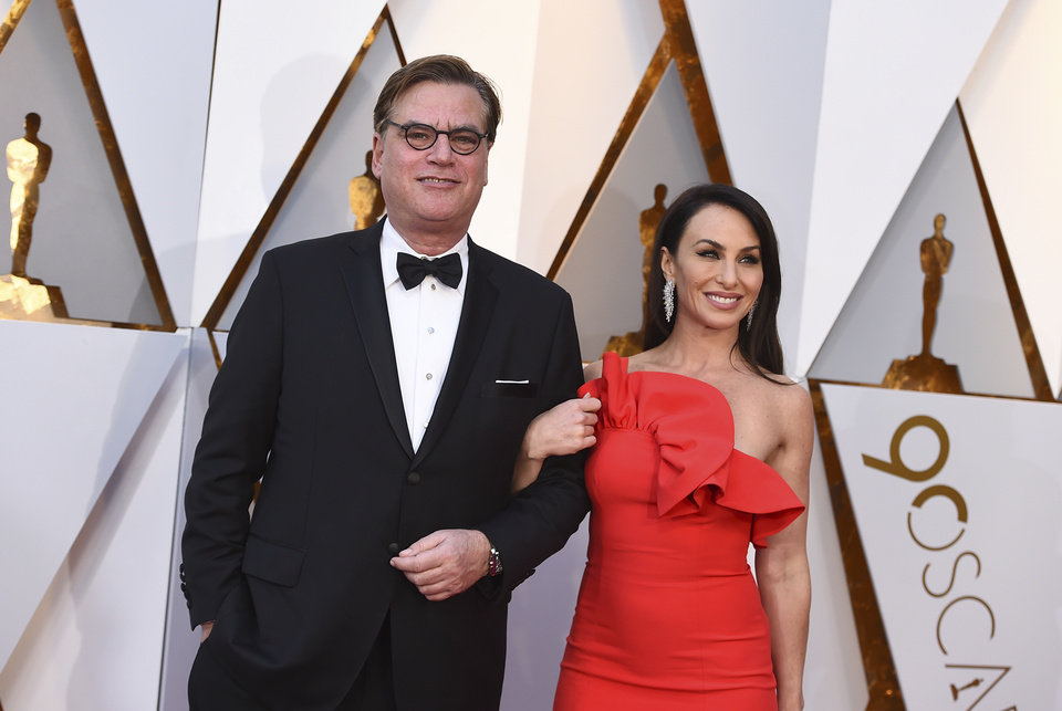 Photo - Aaron Sorkin, left, and Molly Bloom arrive at the Oscars on Sunday, March 4, 2018, at the Dolby Theatre in Los Angeles. (Photo by Jordan Strauss/Invision/AP)