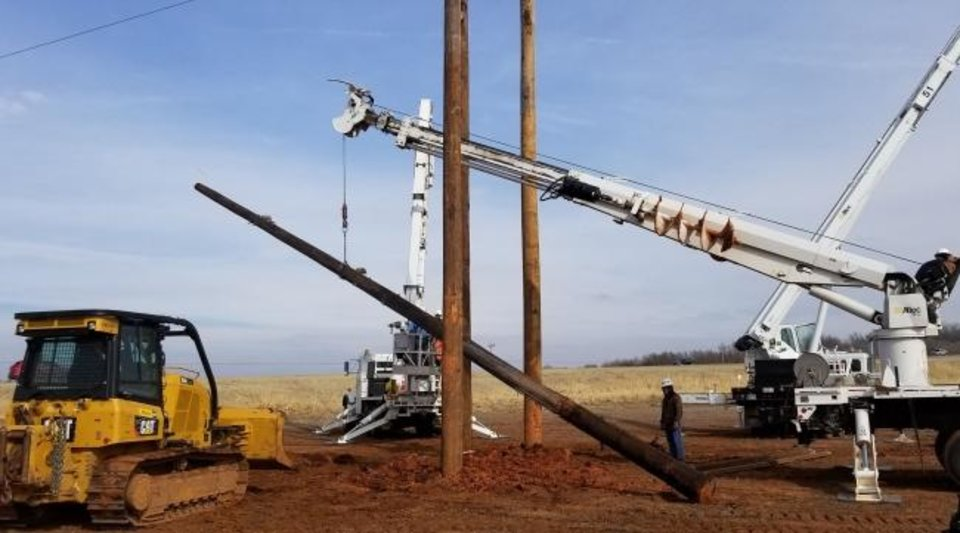 Photo -  Crews set poles used by Western Farmers Electric Cooperative as part of its distribution system. The cooperative routinely taps federal dollars using loans to pay for infrastructure improvements. [PROVIDED BY WESTERN FARMERS ELECTRIC COOPERATIVE]