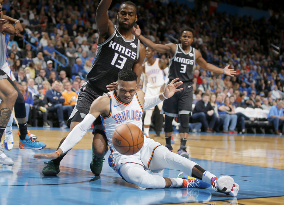 sale retailer 708c3 10477 Oklahoma City s Russell Westbrook (0) falls down in front of Alex Burks of  Sacramento