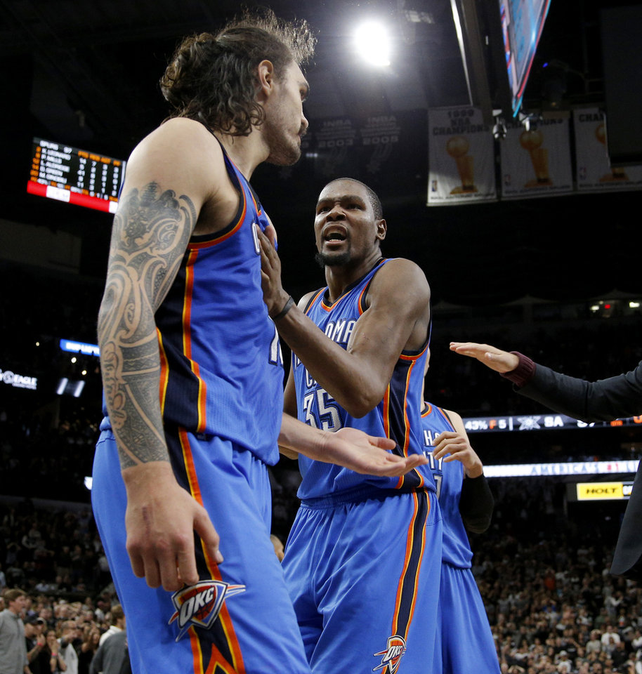 Photo - Oklahoma City's Kevin Durant (35) celebrates with Steven Adams (12) after Game 2 of the second-round series between the Oklahoma City Thunder and the San Antonio Spurs in the NBA playoffs at the AT&T Center in San Antonio, Monday, May 2, 2016. Oklahoma City won 98-97. Photo by Bryan Terry, The Oklahoman
