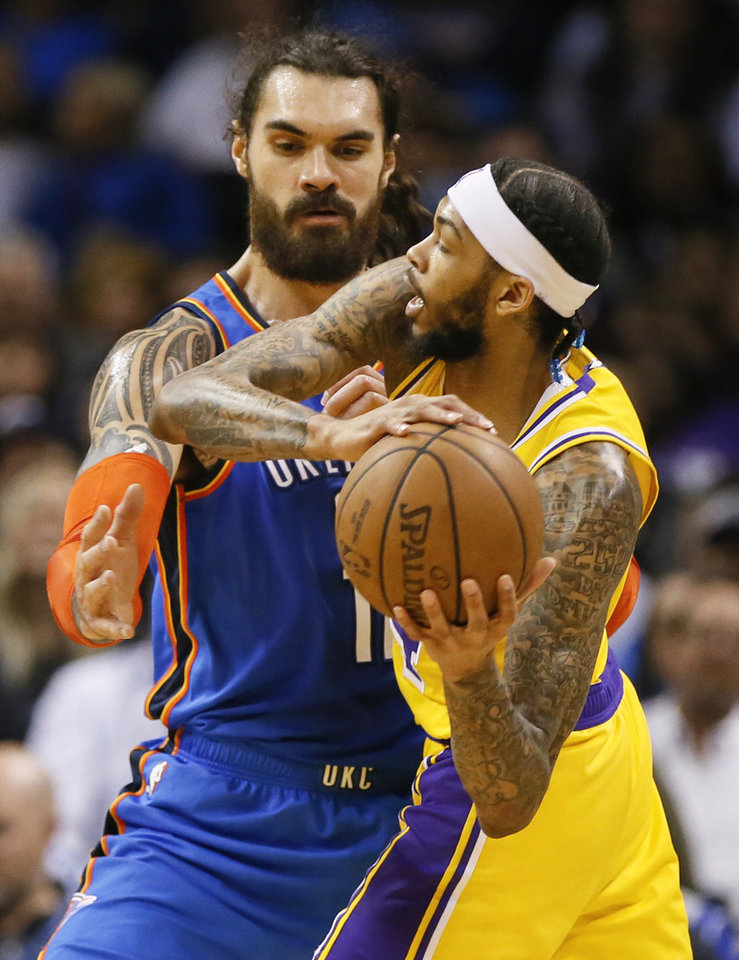 Photo - Oklahoma City's Steven Adams (12) defends Los Angeles' Brandon Ingram (14) during an NBA basketball game between the Los Angeles Lakers and the Oklahoma City Thunder at Chesapeake Energy Arena in Oklahoma City, Thursday, Jan. 17, 2019. Photo by Nate Billings, The Oklahoman