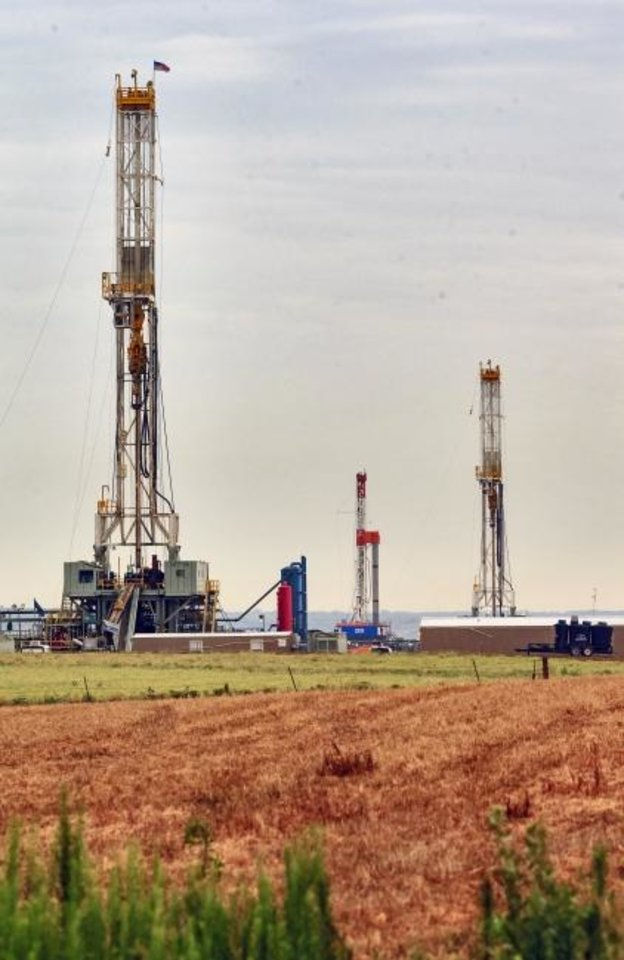 Photo -  Three rigs drill wells in the STACK play last summer. Continental Resources announced Wednesday it sold one of its water handling systems in the eastern portion of the play to Lagoon Water Solutions for $85 million. [OKLAHOMAN ARCHIVES]