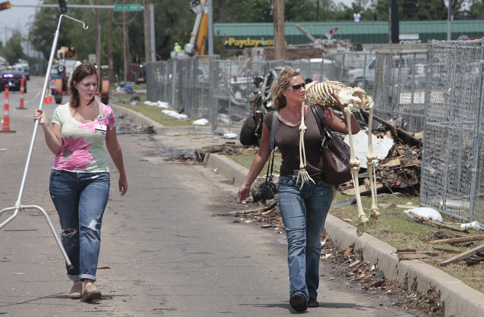 Photo - Kristin Earley, a Doctor of Osteopathic Medicine and her friend Christy Goodger return with Lucy a skeleton that Earley uses in her practice that was lost in the May 20th tornado at the Moore Medical Center, Thursday, May 23, 2013.  Photo by David McDaniel, The Oklahoman