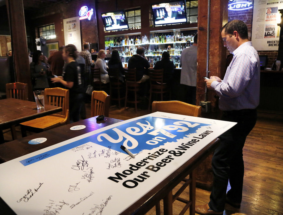 Photo - Celebrating the success of SQ 792 at the election watch party at Bricktown Brewery Tuesday night, Nov. 8, 20016, in Oklahoma City. Photo by Jim Beckel, The Oklahoman