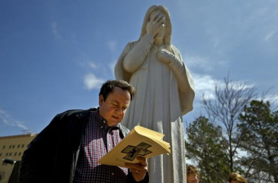 Photo -  The Rev. Don Heath, co-pastor of Edmond Trinity Christian Church, shares a Stations of the Cross scripture reading as people from different Christian denominations gather at the Jesus Wept statue on Good Friday for an Ecumenical Stations of the Cross in downtown Oklahoma City. [Chris Landsberger/The Oklahoman Archives]