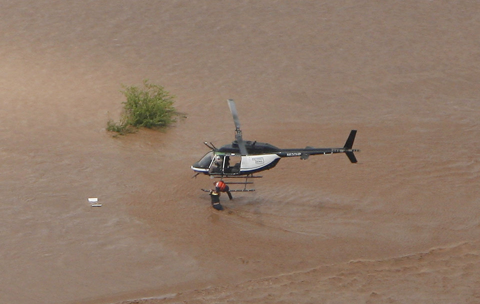 Photo - Flooding in Kingfisher after tropical storm Erin hit the area early Sunday, Aug. 19, 2007. OHP helicopter rescues a man whose pickup was washed off the roadway. BY MATT STRASEN, THE OKLAHOMAN/KWTV SKYNEWS 9