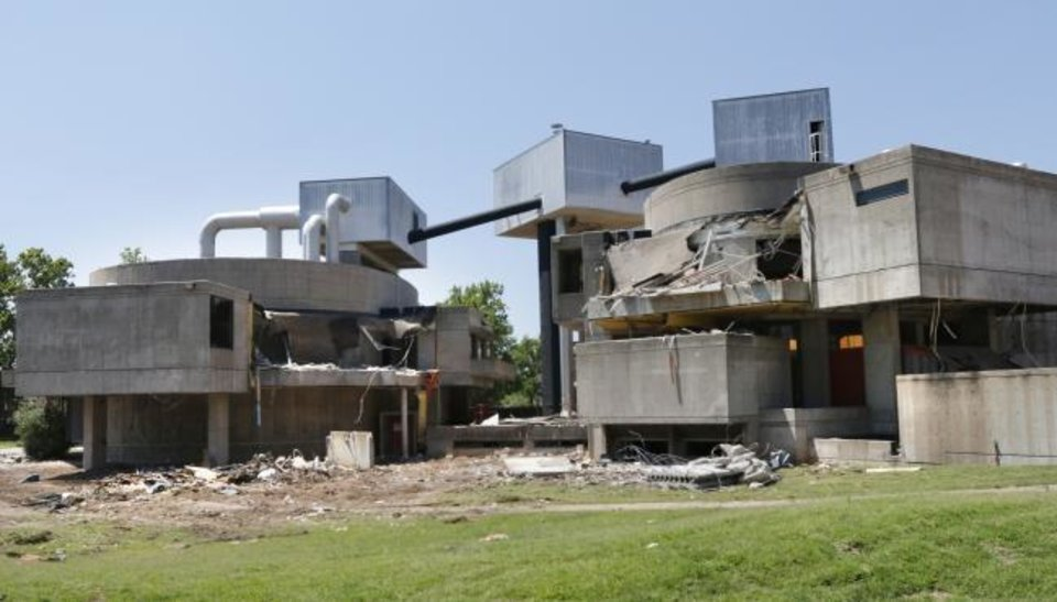Photo -  The architectural and preservation community unsuccessfully tried to stop the 2014 demolition of Stage Center. Plans to replace it with the four-tower OGE Energy Center were scrapped later. [THE OKLAHOMAN ARCHIVES]