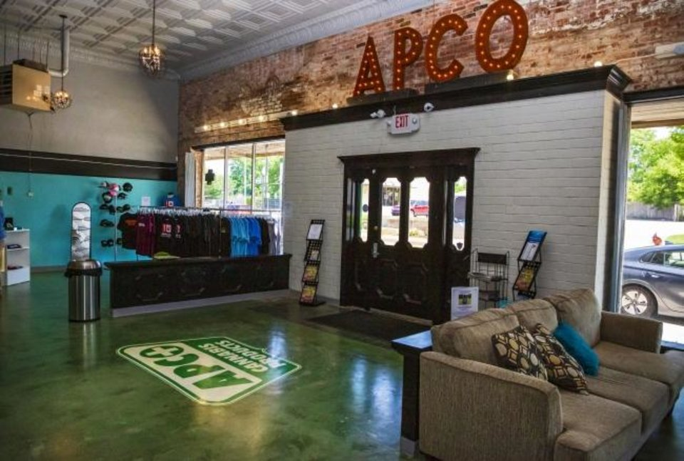 Photo -  The front entrance to APCO MED, located 313 NW 23 is shown on Thursday. APCO has rebranded from oil and gas to be in the medical marijuana industry. [CHRIS LANDSBERGER/THE OKLAHOMAN]