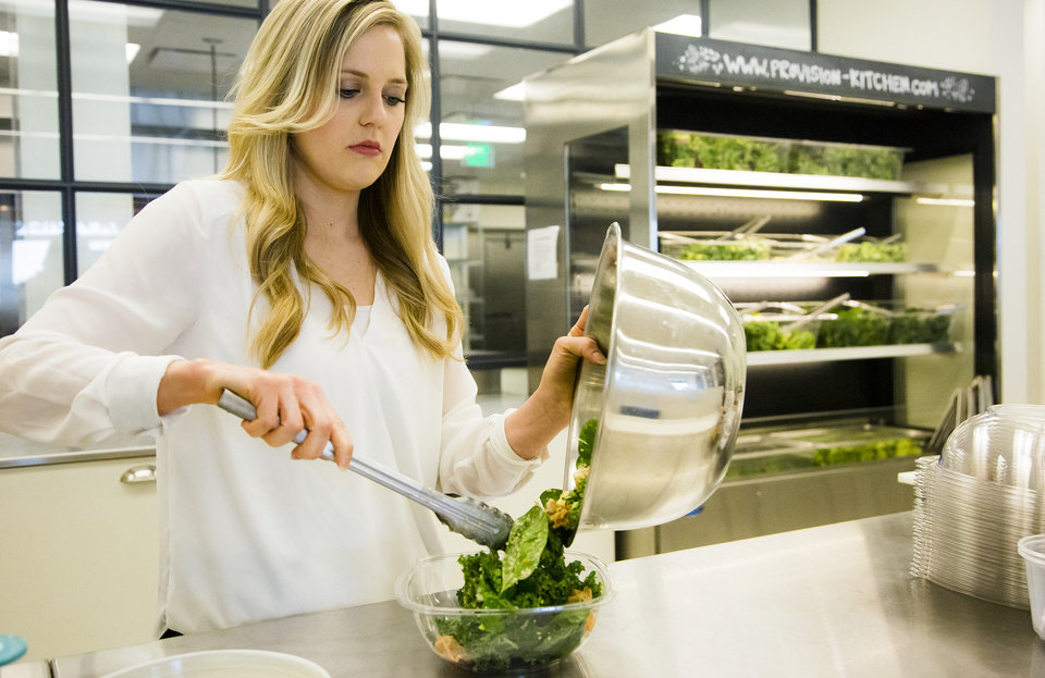 Photo -  Provision Kitchen owner Whitney McClendon prepares a salad high in protein that is essential in the diet of the Baby Boomer generation. [Photo by Chris Landsberger, The Oklahoman]