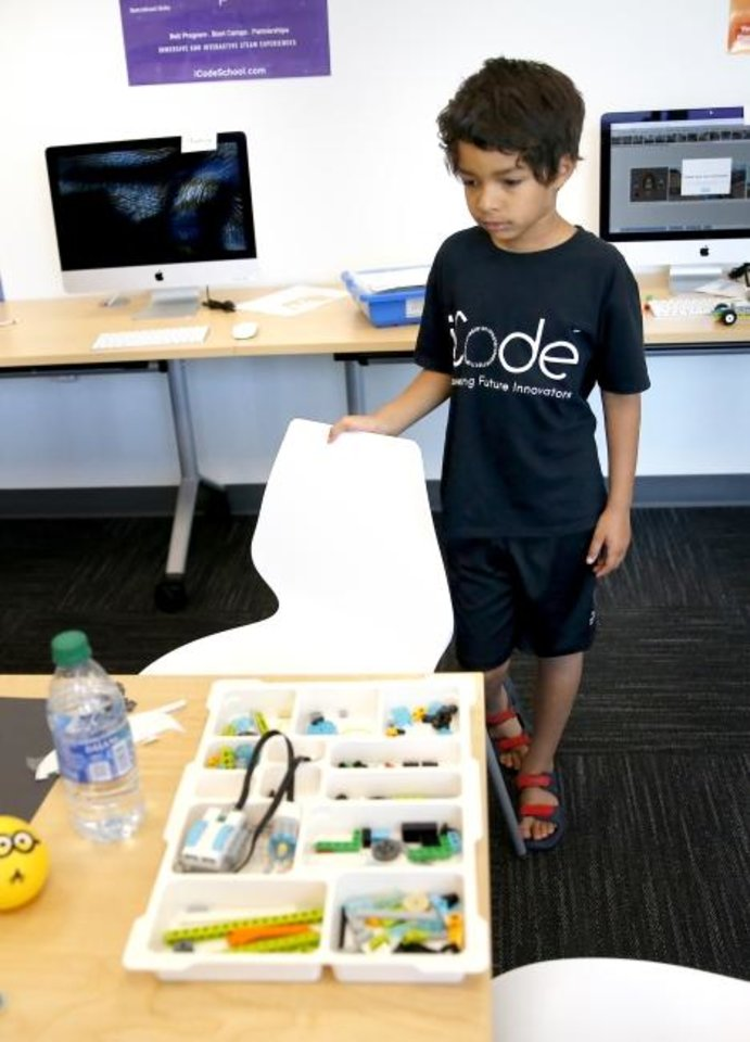 Photo -  Jordon Andrade, 7, helps make a stop-motion video at iCode Edmond. [Sarah Phipps, The Oklahoman]