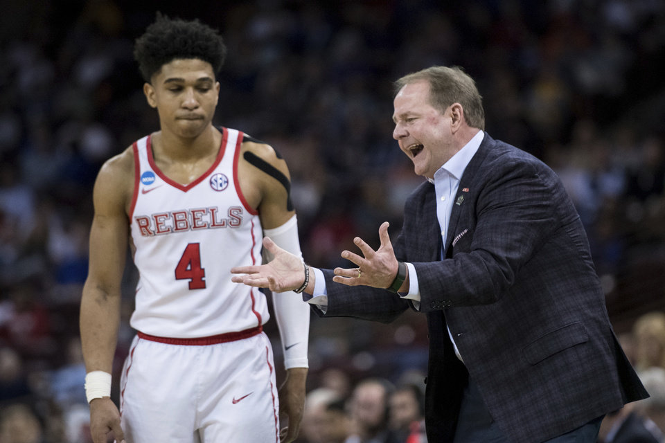 Photo - Mississippi head coach Kermit Davis communicates with Mississippi guard Breein Tyree (4) during a first round men's college basketball game in the NCAA Tournament Friday, March 22, 2019, in Columbia, S.C. (AP Photo/Sean Rayford)