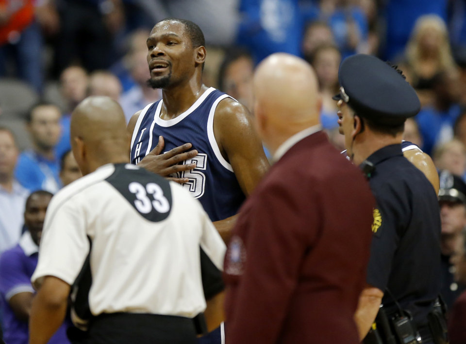 4ecfa17b87f4 Oklahoma City s Kevin Durant (35) walks towards the Dallas bench after  getting ejected during