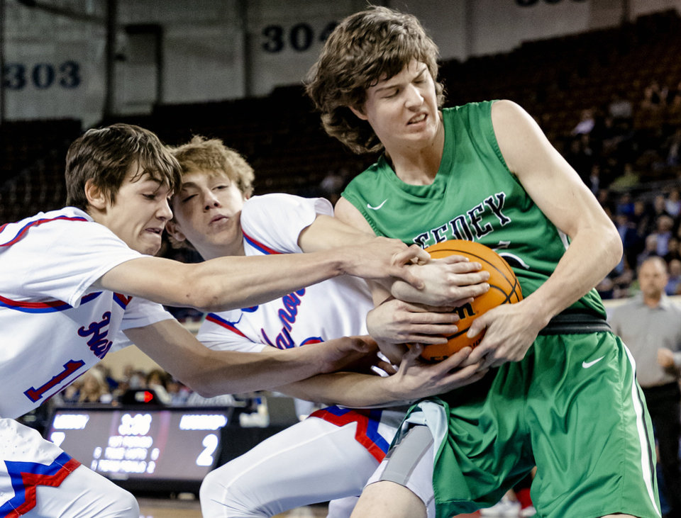 Photo - Leedey's Jack Harrel (35) battles for the ball with Hammon's Peyton Osmond (10) and Trey Torrance (3) during a Class B boys state tournament semi-final basketball game between Hammon vs Leedey in the Jim Norick Arena at State Fair Park in Oklahoma City, Okla. on Friday, March 6, 2020.  [Chris Landsberger/The Oklahoman]