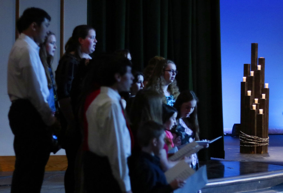 "Photo - The Bishop McGuinness Catholic High School Singers perform at ""Testimony of a Child, the Holocaust Remembrance Day program at Bishop McGuinness High School auditorium, Sunday, May 5, 2019. [Doug Hoke/The Oklahoman]"