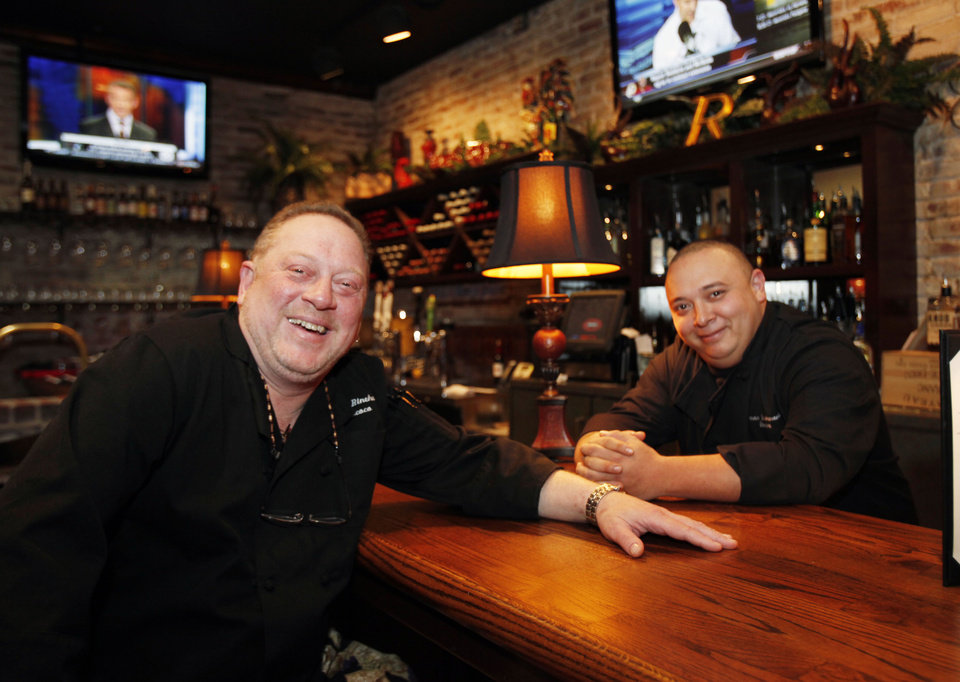Photo - Rococo owner Bruce Rinehart (left) and Chef and Managing Partner Jason Bustamante sit at the bar at Rococo's new location in Northpark Mall in Oklahoma City, OK, Monday, Nov. 15, 2010. By Paul Hellstern, The Oklahoman ORG XMIT: KOD
