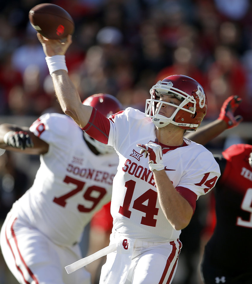 Photo - Oklahoma's Cody Thomas  throws a pass during the college football game between the University of Oklahoma Sooners (OU) and the Texas Tech Red Raiders at Jones AT&T Stadium in Lubbock, Texas, Saturday, November 15, 2014.  Photo by Bryan Terry, The Oklahoman