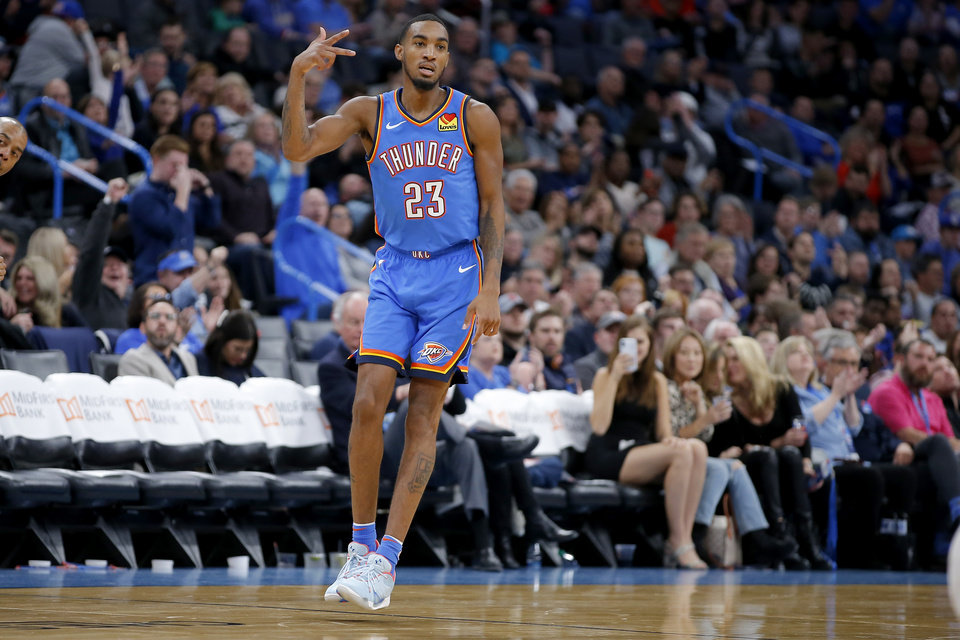 Photo - Oklahoma City's Terrance Ferguson (23) celebrates a 3-pointer during an NBA basketball game between the Oklahoma City Thunder and the Philadelphia 76ers at Chesapeake Arena in Oklahoma City, Friday, Nov. 15, 2019. Oklahoma City won 127-119. [Bryan Terry/The Oklahoman]