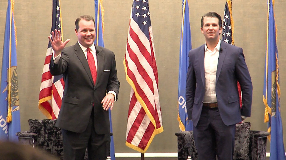 Photo -  Lt. Gov. Todd Lamb, left, introduces Donald Trump Jr. at a fundraising event on Wednesday in Oklahoma City. [Photo by Tim Money, The Oklahoman]