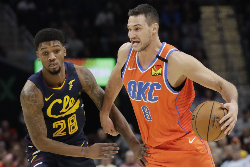 Photo - Oklahoma City Thunder's Danilo Gallinari (8) drives past Cleveland Cavaliers' Alfonzo McKinnie (28) in the second half of an NBA basketball game, Saturday, Jan. 4, 2020, in Cleveland. Oklahoma won 121-106. [AP Photo/Tony Dejak]
