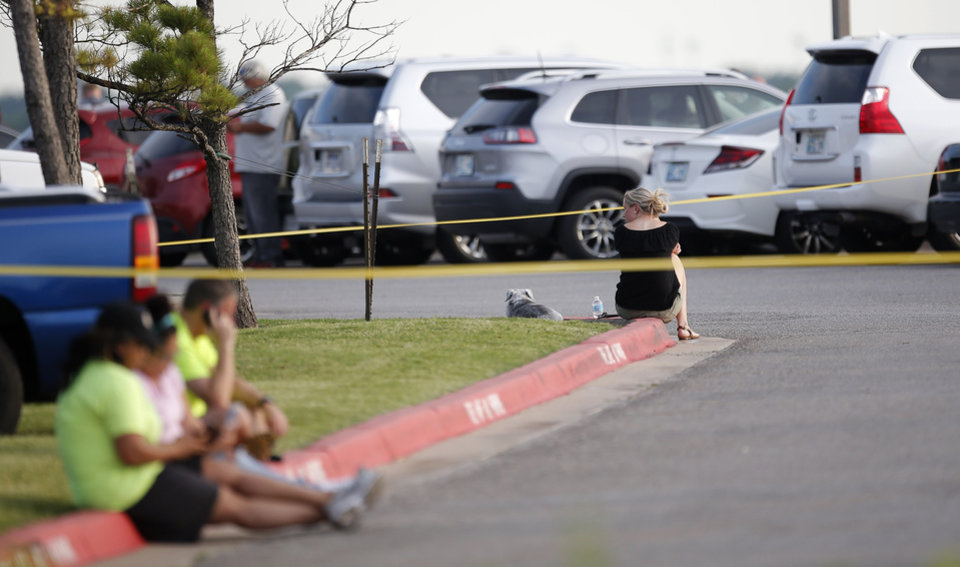 Photo - People remain inside police crime tape as police and emergency personal surround the scene of a shooting on the east side of Lake Hefner in Oklahoma City, Thursday, May 24, 2018.  Photo by Sarah Phipps, The Oklahoman