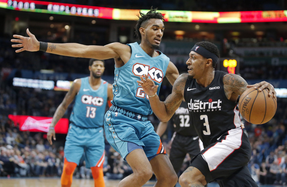 Photo - Washington's Bradley Beal (3) tries to get ast Oklahoma City's Terrance Ferguson (23) during an NBA basketball game between the Oklahoma City Thunder and the Washington Wizards at Chesapeake Energy Arena in Oklahoma City, Sunday, Jan. 6, 2019. Photo by Bryan Terry, The Oklahoman