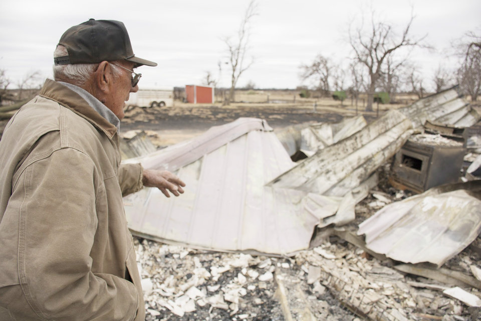 Photo - Bill Zollinger, 80, of Laverne, points out the basement of his childhood home. Wildfires in northwest Oklahoma, Saturday March 11, 2017. Photo by Eriech Tapia, for The Oklahoman