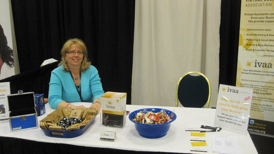 Photo - Nova Scotia-based virtual assistant Kathy Coloaiacovo, mans an informational booth for the International Virtual Assistants Association at the eWomenNetwork conference last month in Dallas. PHOTO PROVIDED