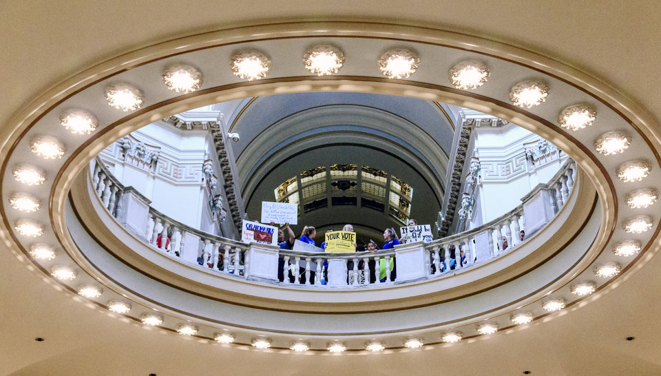 Photo - Teachers and supporters gather in the rotunda during the ninth day of a walkout by Oklahoma teachers at the state Capitol in Oklahoma City, Okla. on Tuesday, April 10, 2018.   Photo by Chris Landsberger, The Oklahoman