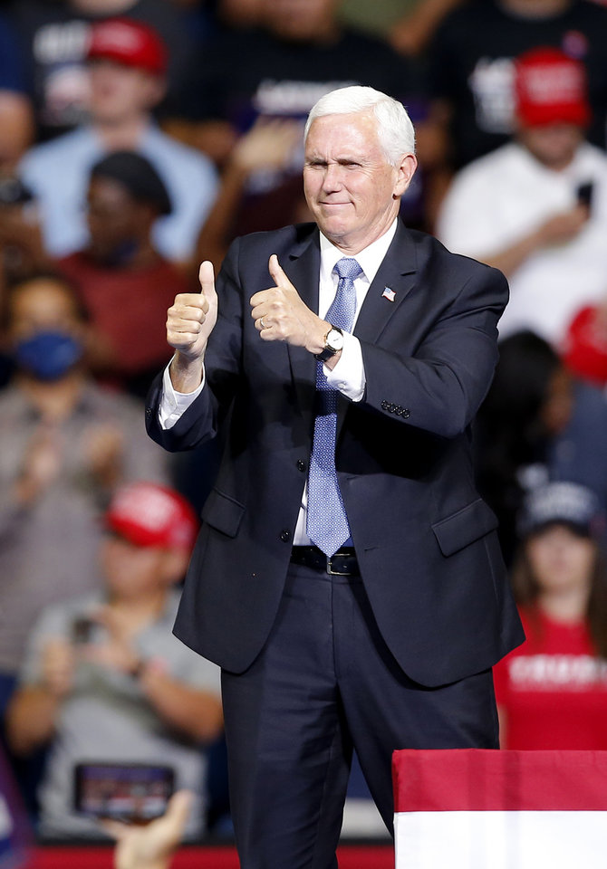 Photo - Vice President Mike Pence gives a thumbs up before speaking during the President Donald Trump rally at the BOK Center in Tulsa, Okla., Saturday, June 20, 2020. [Sarah Phipps/The Oklahoman]
