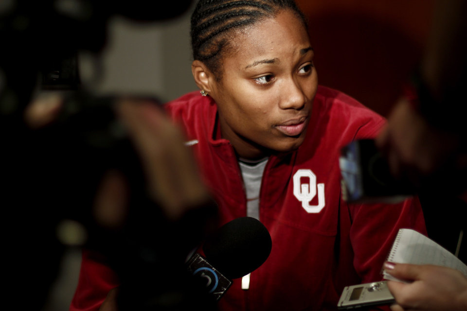 Photo - OU's Amanda Thompson is interviewed in the locker room in Kansas City, Mo., on Monday, March 29, 2010. Oklahoma will play Kentucky in the regional championship game of the NCAA women's tournament on Tuesday, March 29, 2010.