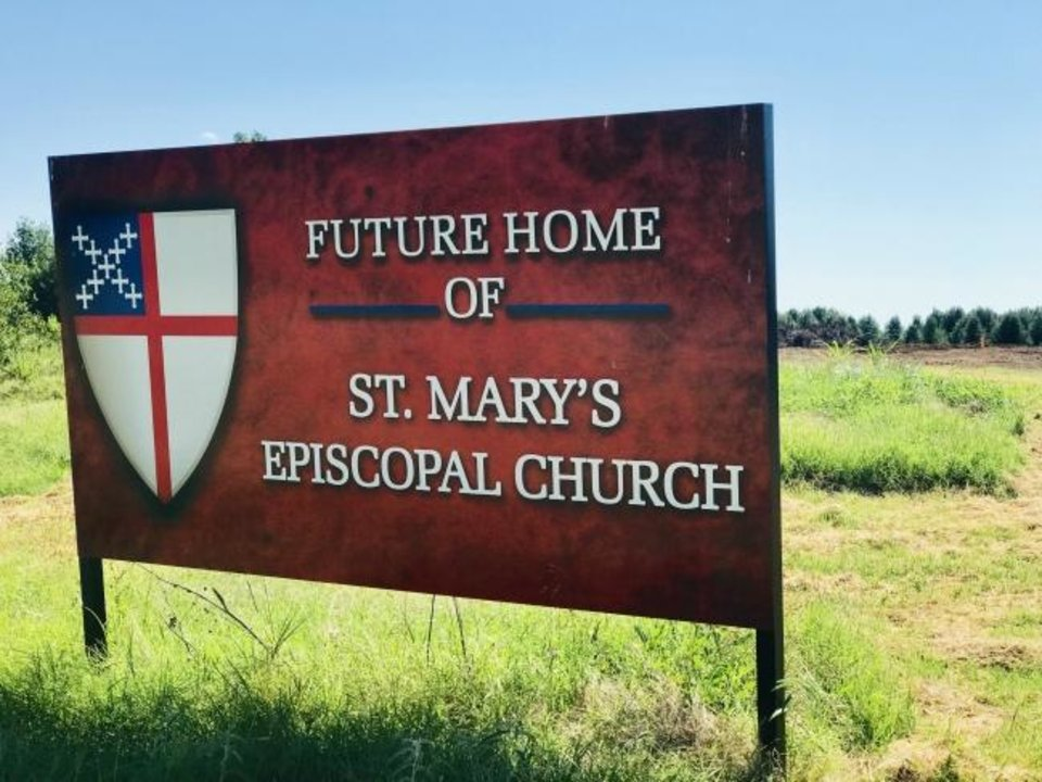Photo -  A sign marking the future home of St. Mary's Episcopal Church sits on property north of the intersection of Covell Road and Broadway in Edmond. [Carla Hinton/The Oklahoman]