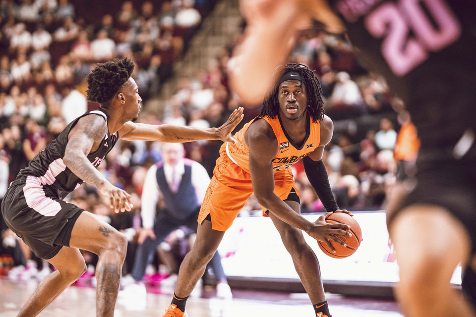 Photo - Isaac Likekele led OSU with 13 points on 6-of-9 shooting Saturday in a 73-62 win at Texas A&M. [Courtney Bay/OSU Athletics]