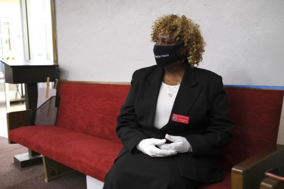 Photo -  Jeanise Jones sits in a pew at her church, Ebenezer Missionary Baptist, 3600 N Kelley. [Doug Hoke/The Oklahoman]