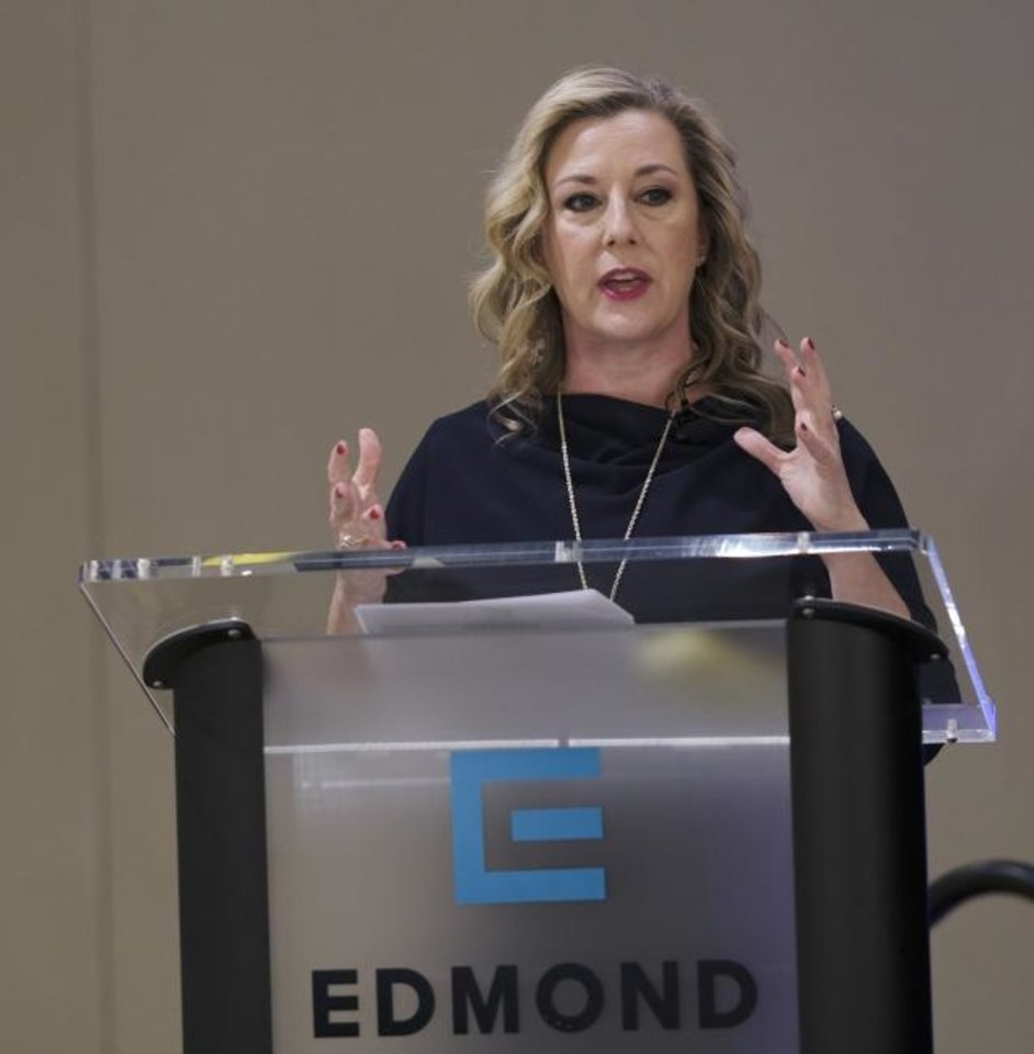Photo -  U.S. Rep. Kendra Horn speaks Wednesday at a 5th District Congressional Forum hosted by the Edmond Chamber of Commerce. [Doug Hoke/The Oklahoman]
