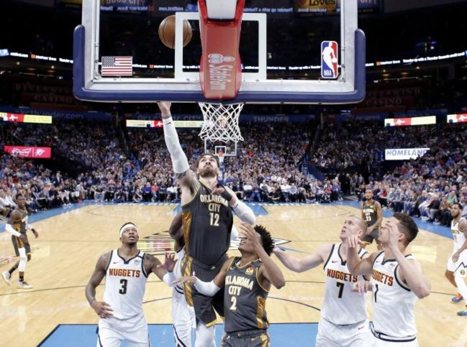 Photo -  Steven Adams (12) goes up for a basket during the Thunder's 113-101 win against the Nuggets at Chesapeake Energy Arena on Friday. [Sarah Phipps/The Oklahoman]